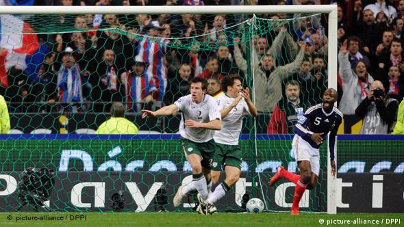 France's Thierry Henry, second left, passes the ball as Ireland's goalkeeper Shay Given, right, tries to stop it, just before William Gallas (unseen) scored the goal for France during their World Cup qualifying playoff second leg soccer match at the Stade de France stadium in Saint Denis outside Paris, Wednesday Nov.18, 2009.