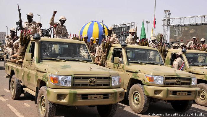 RSF soldiers in trucks at a parade in Khartoum
