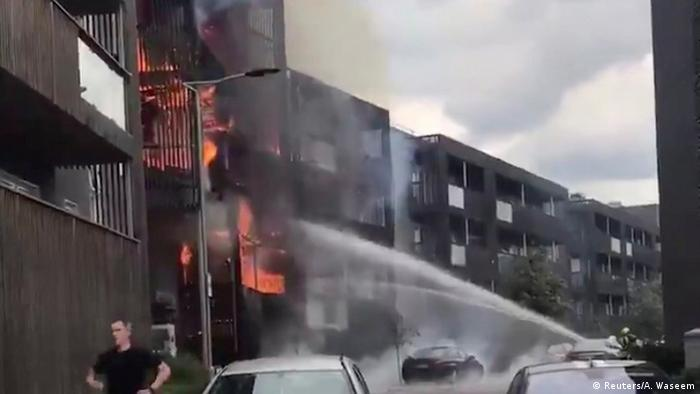 Firefighters spray water at fire in Barking, East London