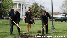 WASHINGTON, DC - APRIL 23: (L-R) U.S President Donald Trump, U.S. first lady Melania Trump and French President Emmanuel Macron participate in a tree-planting ceremony on the South Lawn of the White House April 23, 2018 in Washington, DC. The European Sessile Oak is a gift from the Macrons and comes from Belleau Woods, where more than 9,000 American marines died during battle in June 1918 during the First World War. According to the first lady's office The forest is a memorial site and important symbol of the sacrifice the United States made to ensure peace and stability in Europe. (Photo by Chip Somodevilla/Getty Images)