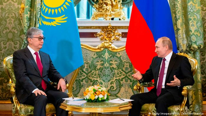 Russia's President Vladimir Putin speaks with Kazakhstan's new president Kassym-Jomart Tokayev during a meeting at the Kremlin