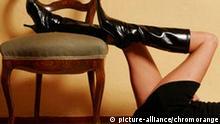 Frauenbeine in Stiefeln