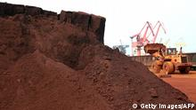 TO GO WITH China-Japan-technology-commodities FOCUS by D'Arcy Doran In a picture taken on September 5, 2010 a man driving a front loader shifts soil containing rare earth minerals to be loaded at a port in Lianyungang, east China's Jiangsu province, for export to Japan. China's restrictions on exports of rare earths are aimed at maximising profit, strengthening its homegrown high-tech companies and forcing other nations to help sustain global supply, experts say. China last year produced 97 percent of the global supply of rare earths -- a group of 17 elements used in high-tech products ranging from flat-screen televisions to iPods to hybrid cars -- but is home to just a third of reserves. CHINA OUT AFP PHOTO (Photo credit should read STR/AFP/Getty Images)
