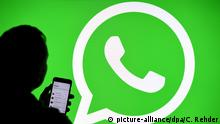 Логотип WhatsApp и силуэт пользователя