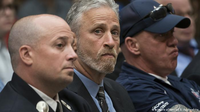 Comedian Jon Stewart with 9/11 first responders at the House Judiciary Committee in Washington DC