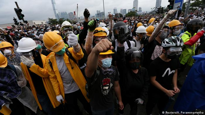 Protestors in helmets