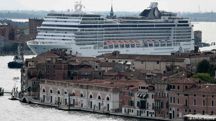Large cruise ship sailing across the lagoon in Venice, Italy
