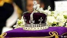 The coffin of Britain's Queen Mother, adorned with her personal standard, her crown, a wreath and a note from her daughter, Queen Elizabeth II, is drawn to London's Westminster Hall Friday April 5, 2002 in a ceremonial procession. (AP Photo/Alastair Grant)