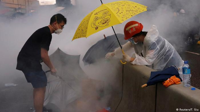 Protesters deal with tear gas during Wednesday's demonstration