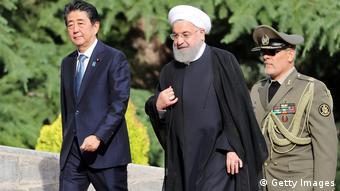 O presidente do Irã, Hassan Rohani (no centro)