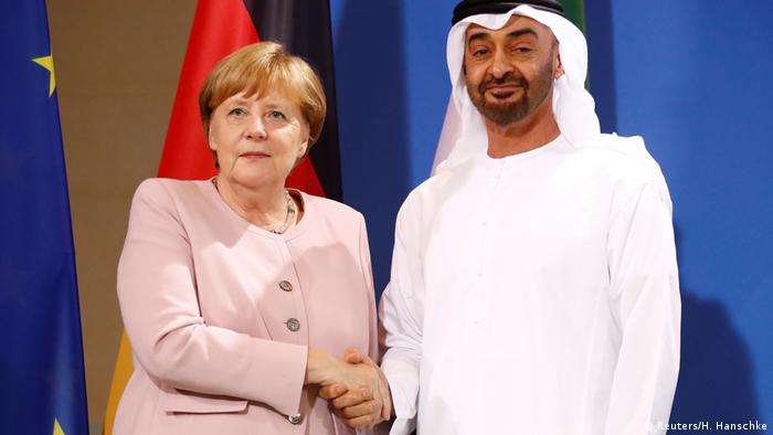 Angela Merkel shakes hands with Mohammed bin Zayed Al Nahyan in Berlin