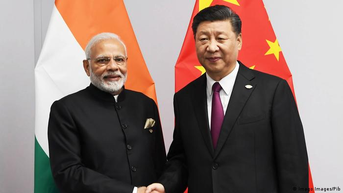 Indian PM Modi (left) shakes hands with Chinese President Xi before a bilateral meeting on the sidelines of the G20 Summit meeting in Buenos Aires in November 2018