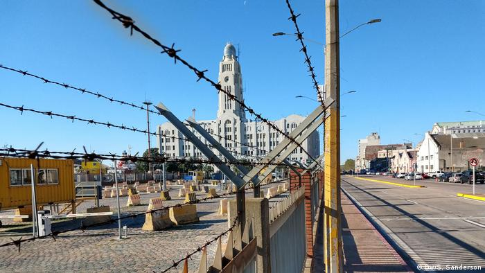 Harbor building behind barbed-wire fencing in Montevideo