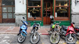 Motorbikes old and new parked outside a cafe in Montevideo