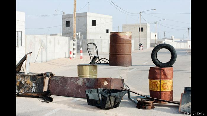 A series of metal drums and tires in a photo by Martin Kollar, Field Trip, Israel, 2009-2011 (Martin Kollar)