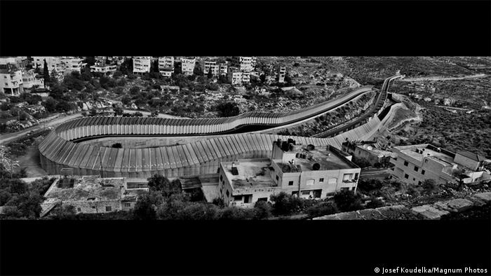 A black-and-white photo shows Bethlehem from above, Route 60, Beit Jala, Bethlehem area. (Josef Koudelka/Magnum Photos)