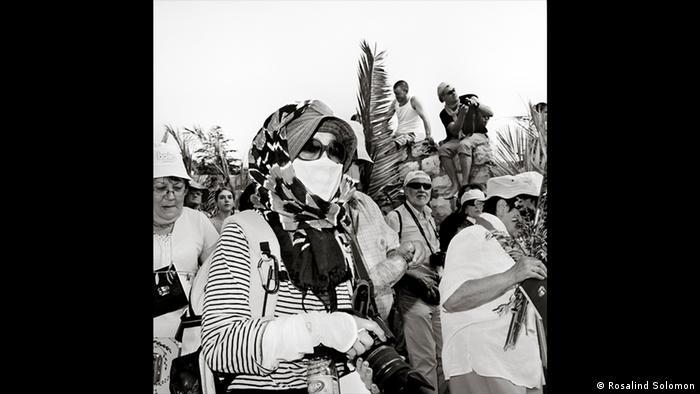 Black-and-white photo of the artist Rosalind Solomon, taken at a demonstration in Jerusalem, 2011 (Rosalind Solomon)