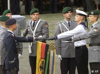 German soldiers taking oath in front of a German national flag