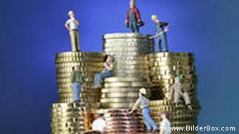 People of various occupations stand on top of coins
