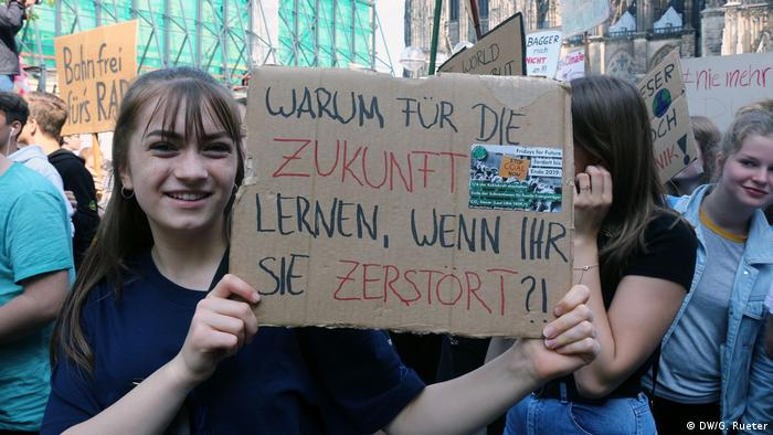 A student in Cologne with a sign that reads Why study, if our future is being destroyed?