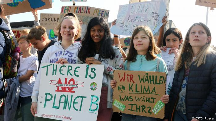 Children with climate protest signs in Cologne