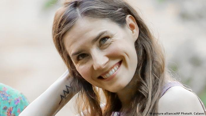 Amanda Knox smiles while attending a cocktail in Modena. Italy