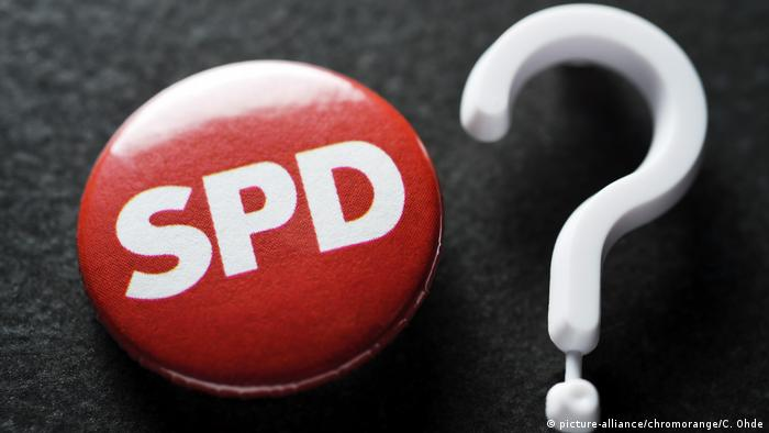 German SPD's record low in poll adds to strain on Merkel's coalition
