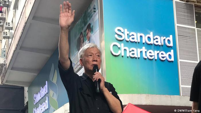 Reverend Chu waving to protesters in Hong Kong