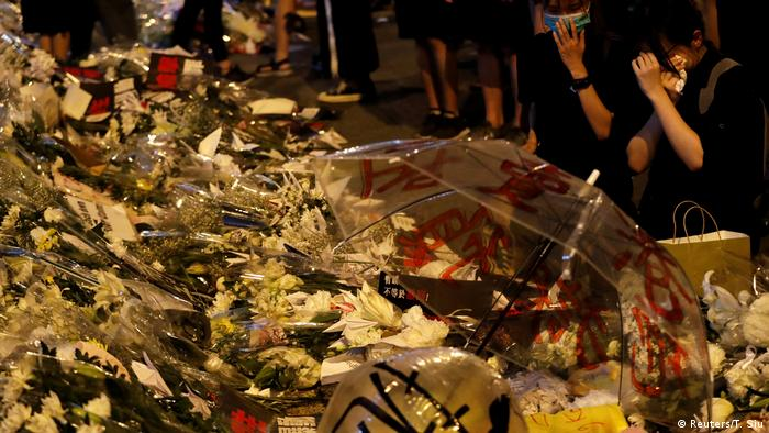 Flowers mark the place where a man died while protesting