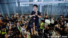 Pro-democracy activist Joshua Wong addresses the crowds outside the Legislative Council during a demonstration demanding Hong Kong's leaders to step down and withdraw the extradition bill, in Hong Kong, China, June 17, 2019. REUTERS/Thomas Peter