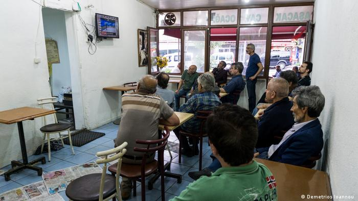 Men in a café watch the election results on television in Kasimpasa, Istanbul