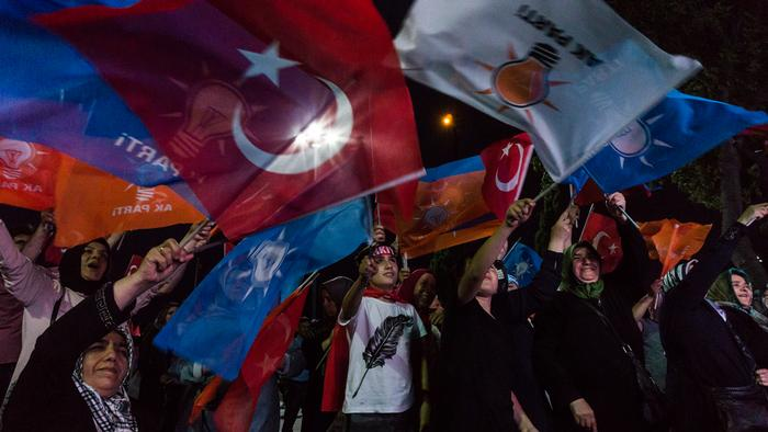 Supporters of the AKP wave flags in celebration, Kasimpasa, Istanbul