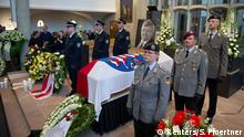 FILE PHOTO: An honour guard made of Police and Federal Armed Force officers stands next to the coffin of the Kassel District President, Walter Luebcke, who was shot, during his funeral at the St. Martin Church in Kassel, Germany, June 13, 2019. Swen Pfoertner/Pool via REUTERS/File Photo