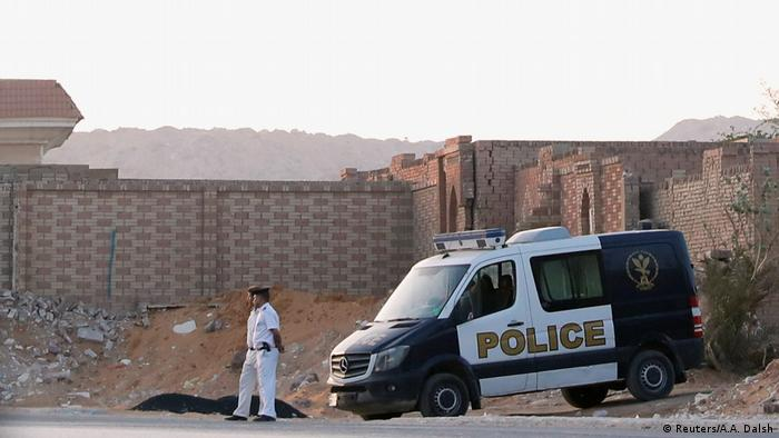 Police van and officers in Cairo
