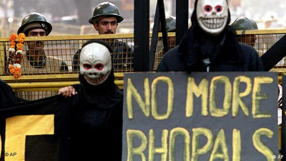 Activists from Greenpeace stage a protest in front of parliament in New Delhi Friday December 3, 1999on the 15th anniversary of the Union Carbide disaster in Bhopal Photo: AP Photo/John McConnico