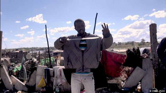 Man holding up jacket