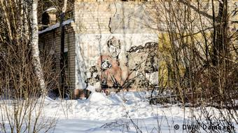 Old propaganda painting on a wall in Chernobyl, Ukraine