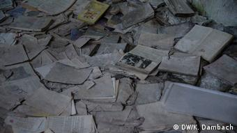 Books and papers that have been discarded in Pripyat in Ukraine after the 1986 Chernobyl nuclear disaster