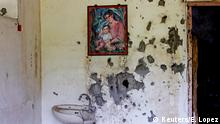 A painting of a mother and a child hangs on a wall at a bullet-riddled structure in Marawi City, Lanao del Sur province, Philippines, May 11, 2019. The war-torn area remains abandoned two years since pro-Islamic State militants began their attacks on May 23, 2017. REUTERS/Eloisa Lopez SEARCH MARAWI SECURITY FOR THIS STORY. SEARCH WIDER IMAGE FOR ALL STORIES.