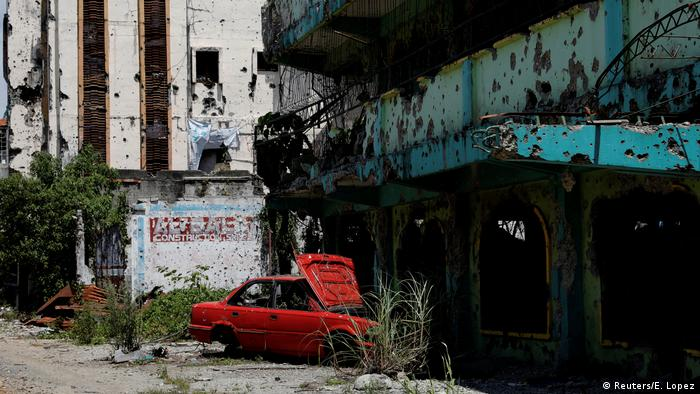 A dilapidated car and establishment are seen at the most affected war-torn area of Marawi City