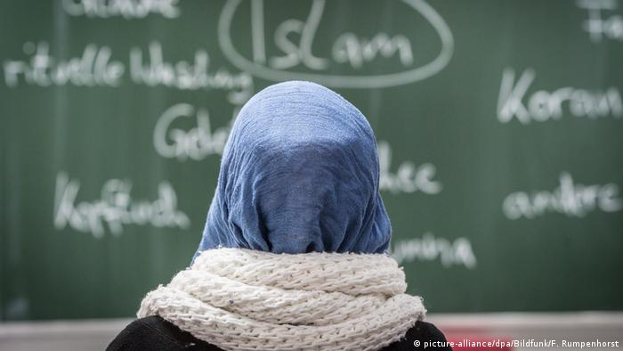 A girl with a headscarf at school