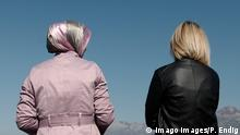 two women looking at mountain