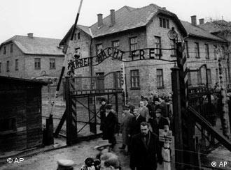 Members of the Frankfurt Auschwitz Trial Commission pass through the main gate of the former Nazi concentration camp in Auschwitz, Poland