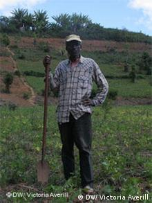Malgasy farmer Dimasy standing on cutivated land in eastern Madagascar, that used to be rainforest when he was a child.