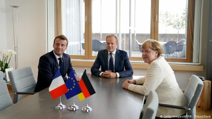 Emmanuel Macron, Donald Tusk and Angela Merkel in Brussels
