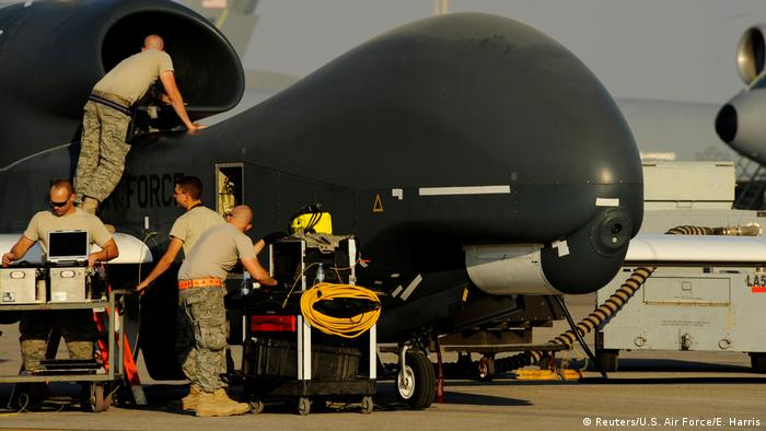 US Air Force maintainence officers prepare a military drone