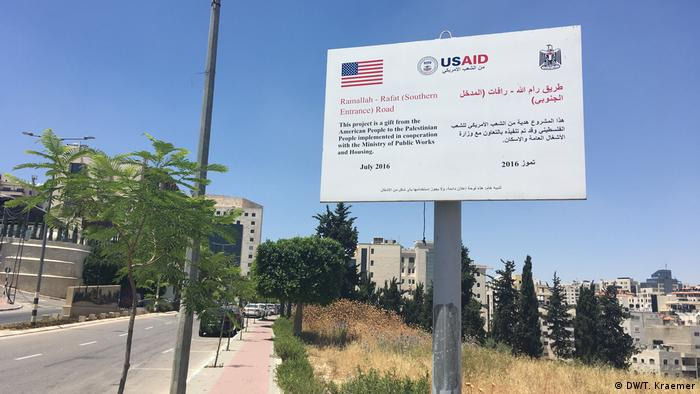 A USAID sign in Ramallah