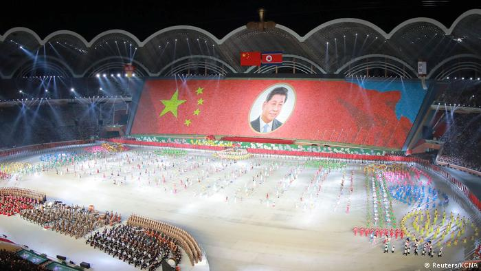A mass display is held showing the image of China's President Xi Jinping