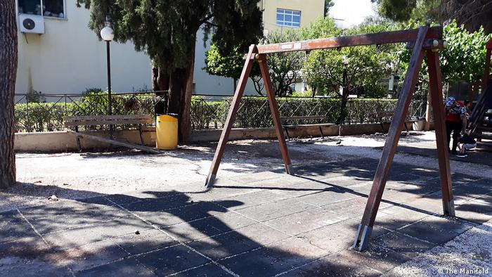 A swing set lacking swings at a playground at Aghia Sofia Pediatric Hospital in Athen