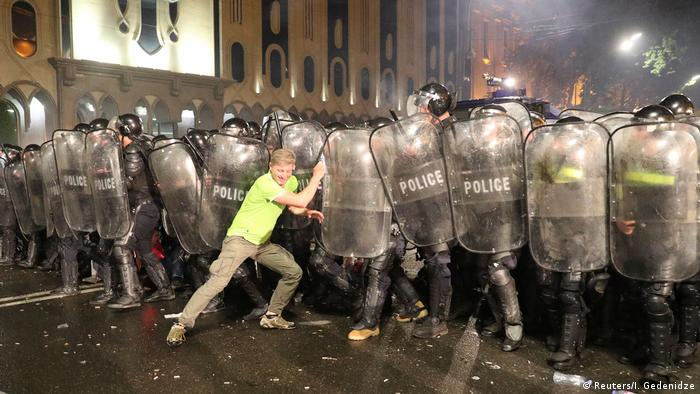 Protester and police in Tbilisi